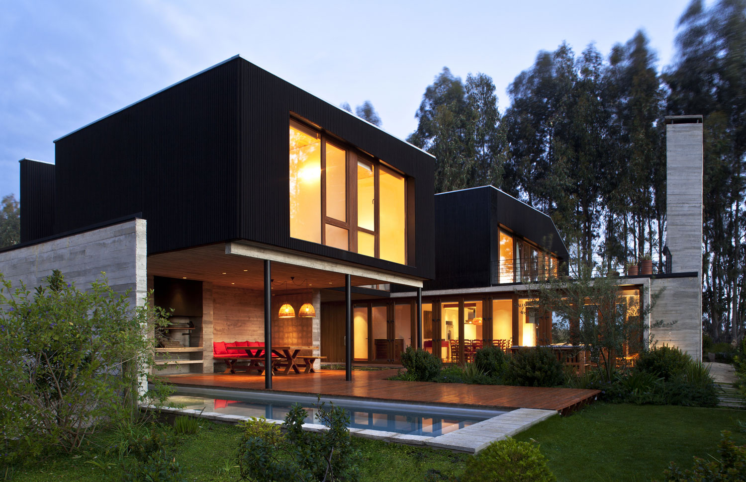 rock house with black painted wood