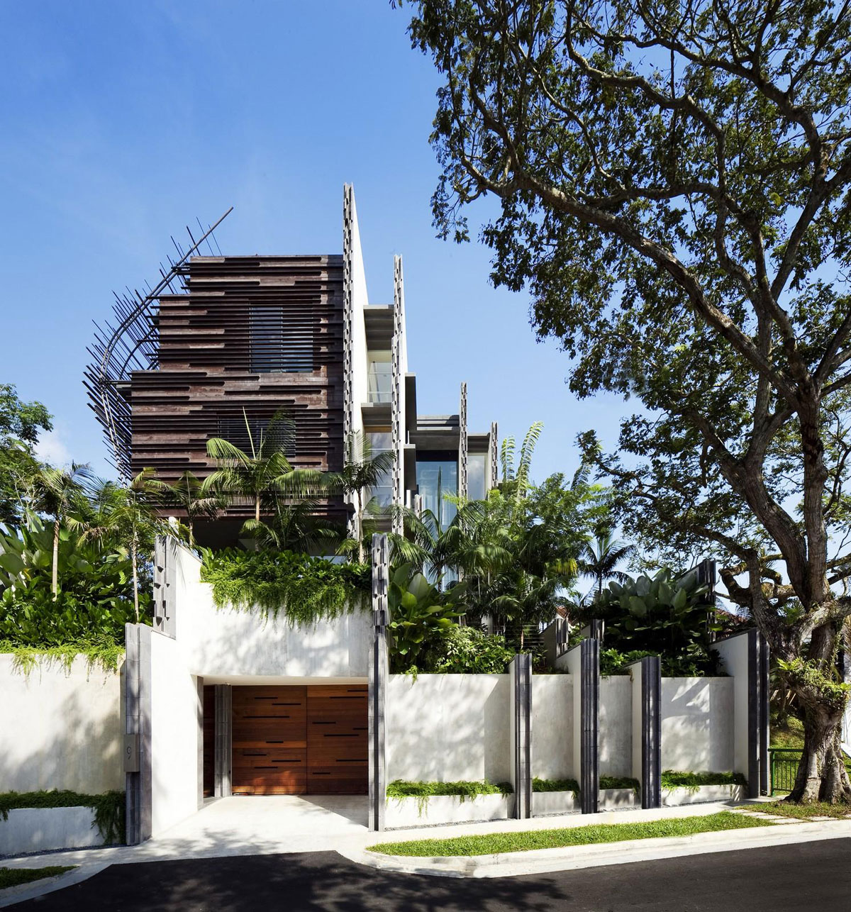 Raw nest house by woha architects for Raw space architects