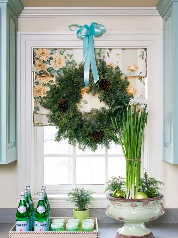 another decorative and beautiful idea is to create a holiday arrangement right on your window sill in the kitchen or living room where you spend time with - Window Sill Christmas Decorations